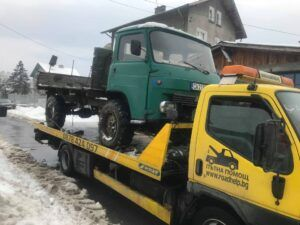 превоз на камион със превоз на камион със пътна помощпътна помощ